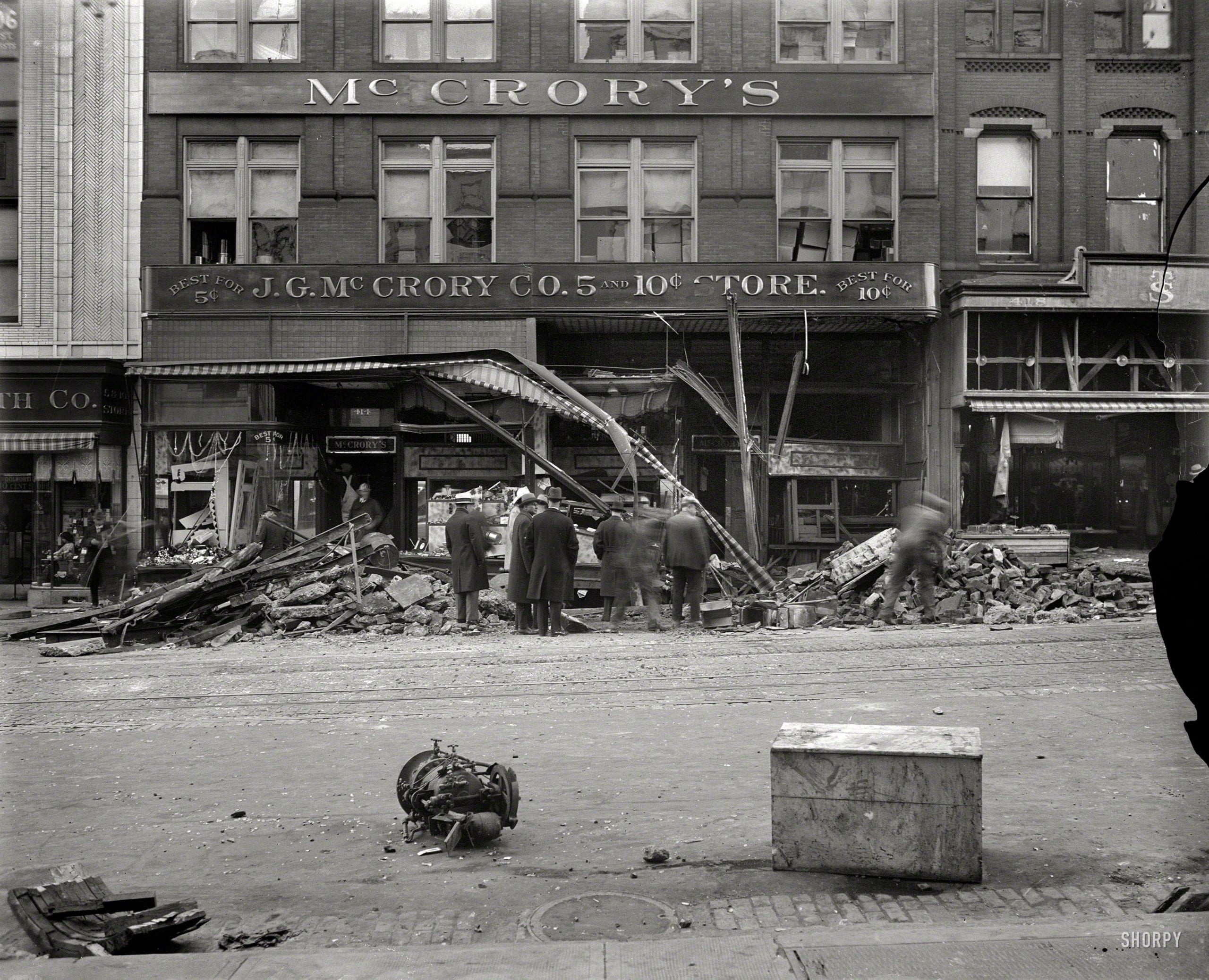 Aftermath of the McCrory disaster, a virtually forgotten chapter in the history of Washington, D.C.: At 1:32 p.m. on Nov. 21, 1929, a boiler in the basement of the McCrory five-and-dime store at 416 Seventh Street NW exploded, demolishing the ground floor and igniting a fire in a deafening blast whose final toll was six dead and dozens injured. Harris & Ewing Collection glass negative.