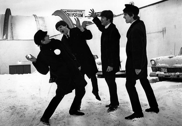 The Beatles play in the snow outside Washington Coliseum