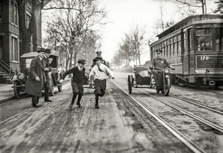"""Washington, D.C., circa 1922. """"NO CAPTION (Children, police motorcycles with sidecars, and streetcar in street)."""" From a series of photos whose subject seems to be traffic safety. Harris & Ewing Collection glass negative."""