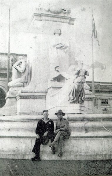 John Henry Balch, Corpsman, U.S. Navy, visiting Washington, D.C., in June 1917 [at Columbus statue at Union Station], while awaiting shipment overseas. The Marine on the right is not identified. [Portraits.] [Scene, World War I, World War 1.] John Henry Balch. 06/1917; NH 80571; Courtesy of Commander J.H. Balch, U.S. Navy (retired), 1974.