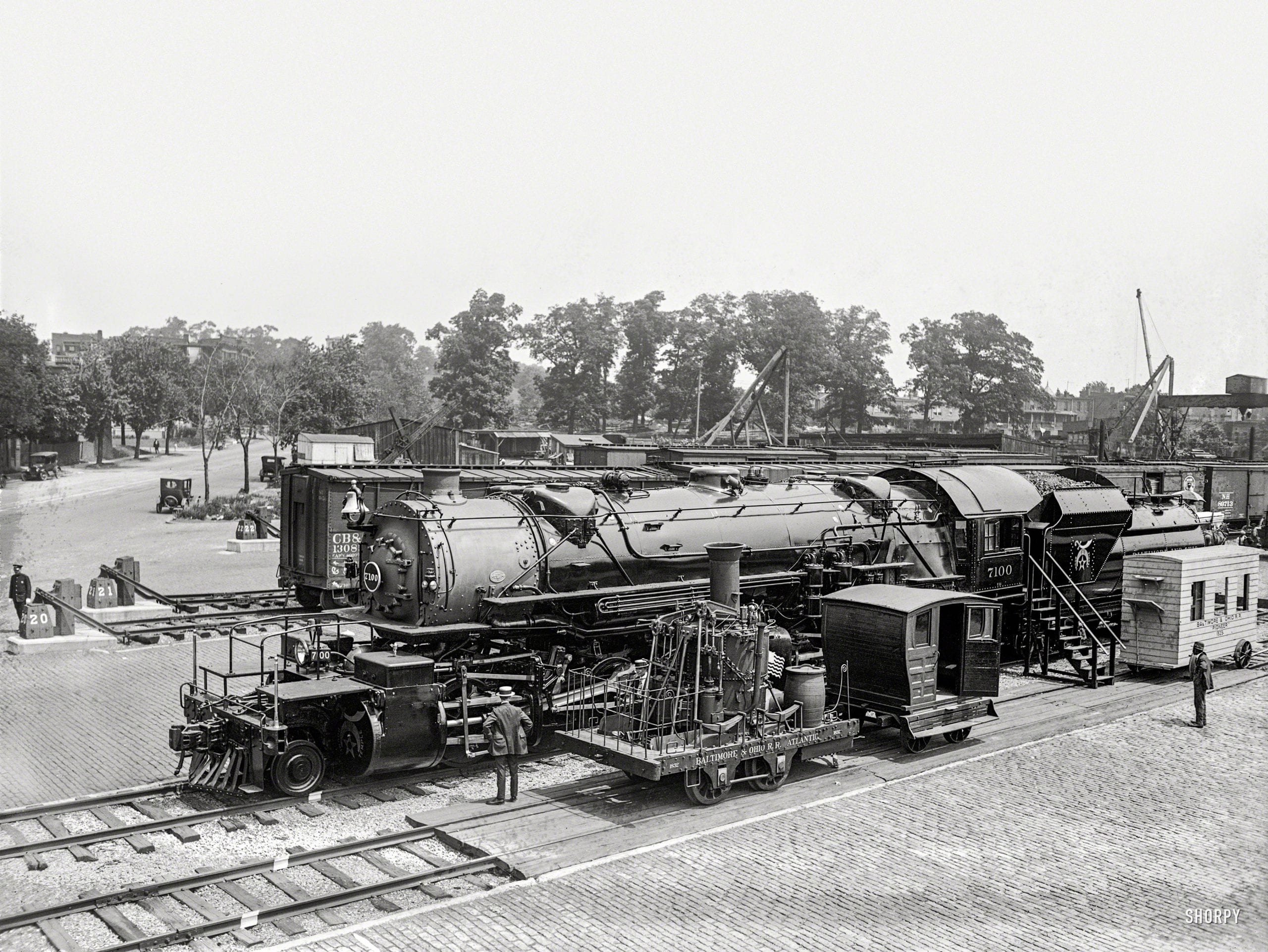 """""""Past and present in locomotives. Eckington Yards, June 4, 1923."""" A closeup of the locomotive in the Baltimore & Ohio rail yard during the Masonic convention in Washington, D.C. The big engine wears the livery of """"Boumi Temple,"""" a Baltimore Shrine lodge. 5x7 glass negative."""