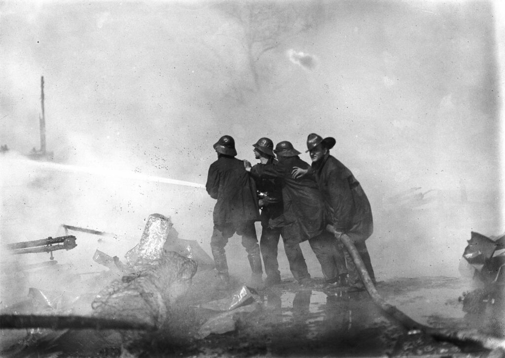 Firemen attempting to put out the fire at Boundary Field