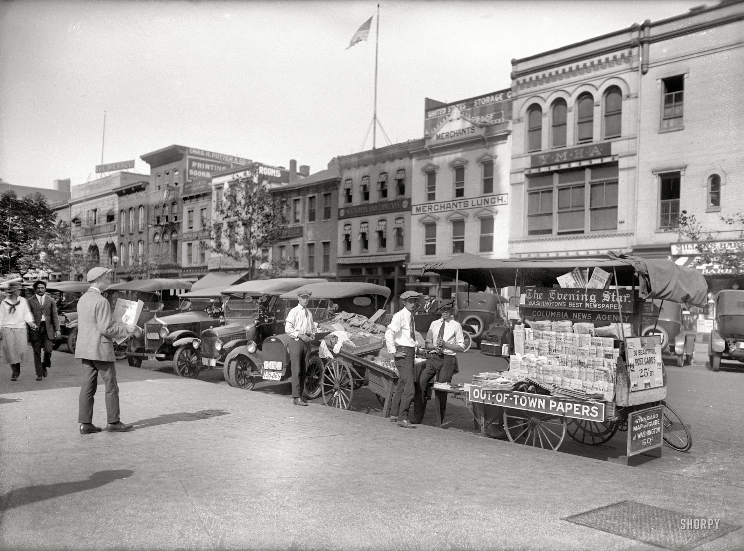"Washington, D.C., 1921. ""National Fruit Co."" Out-of-town bananas and news. National Photo Company Collection glass negative."