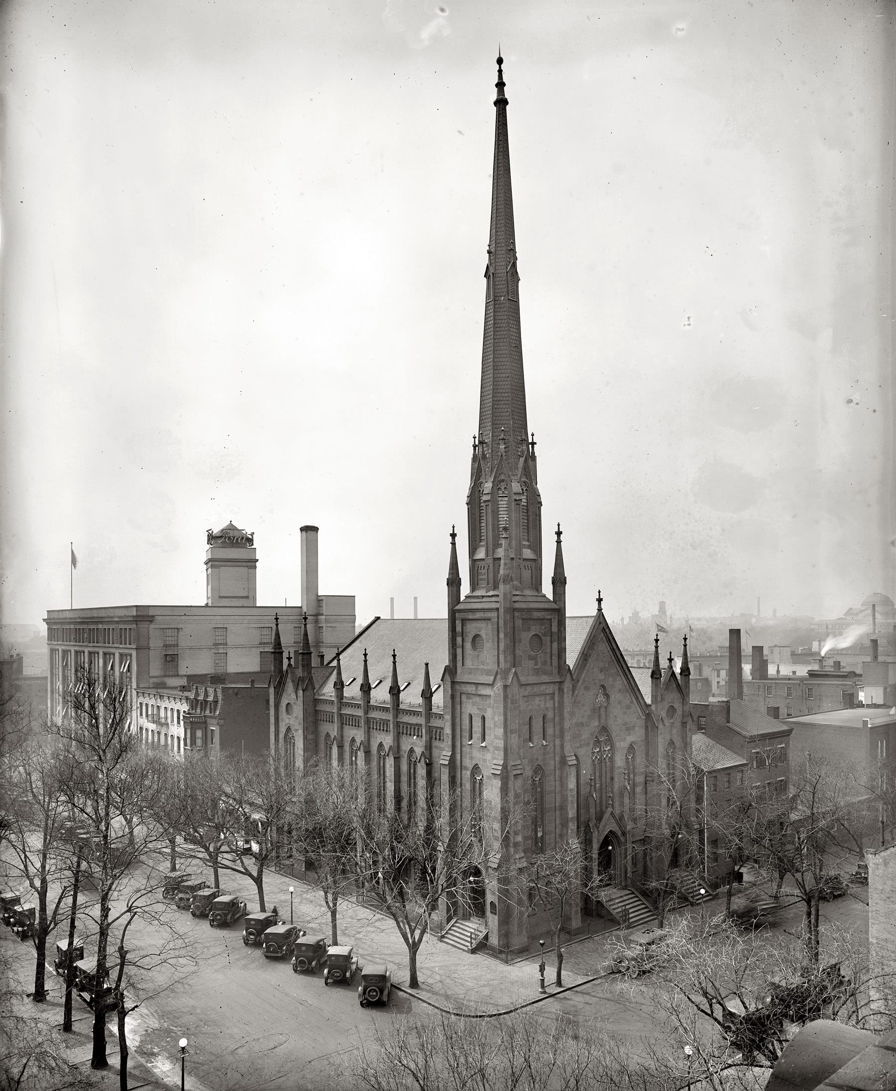 "Circa 1924, ""Metropolitan Methodist Church, C Street, Washington, D.C."" And the Ford building next door. National Photo Company glass negative. View full size. The church, at C Street NW and John Marshall Place, was abandoned and razed after the congregation moved to its Nebraska Avenue location in the 1930s. The 1905 Ford Motor Co. building on Pennsylvania Avenue was torn down in 1980."