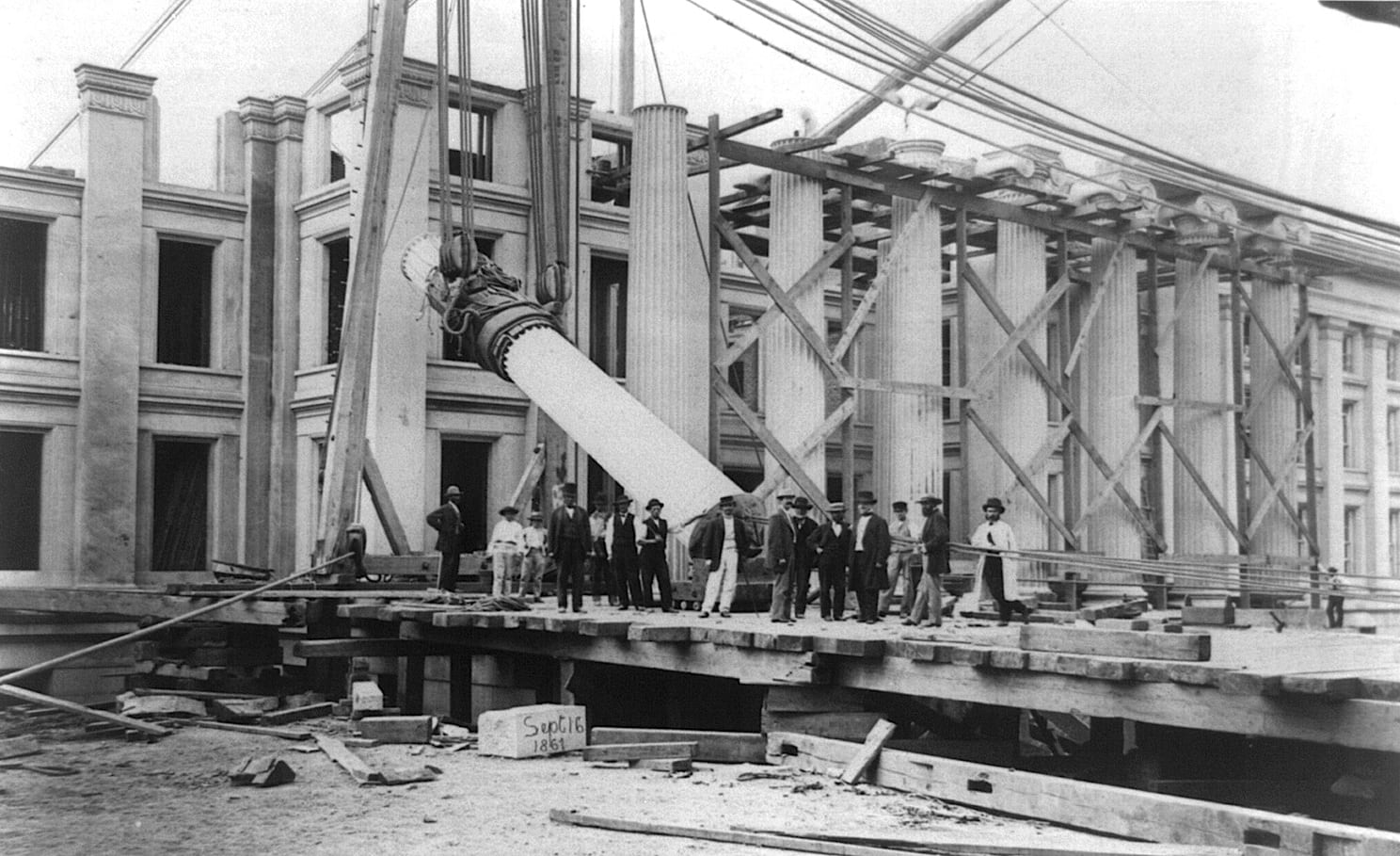 Construction of Treasury Building, Washington, D.C.: Men standing in front; column being raised into position, Sept. 16, 1867
