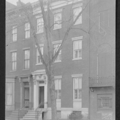 View of 1736 I Street NW, a three-story row house that was the last residence of Jefferson Davis. Flanking each side of the structure are partial views of 1738 and 1734 I Street NW.