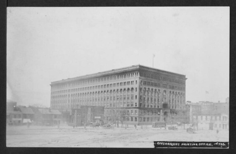 Long-distance view of the Government Printing Office on the northwest corner of North Capitol and G Streets NW showing structures in the 600 block of North Capitol and a streetcar heading south on North Capitol.