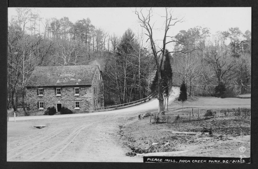 View of south and west elevations of Peirce Mill, to the left of Tilden Street NW as it rises to cross Rock Creek.