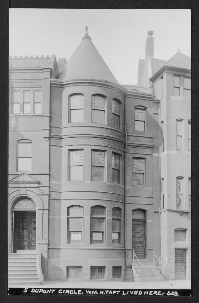 View of 5 Dupont Circle NW where President William H. Taft once lived. FOR RENT signs are taped into the first floor windows. Image also includes partial views of 4 and 6 Dupont Circle.