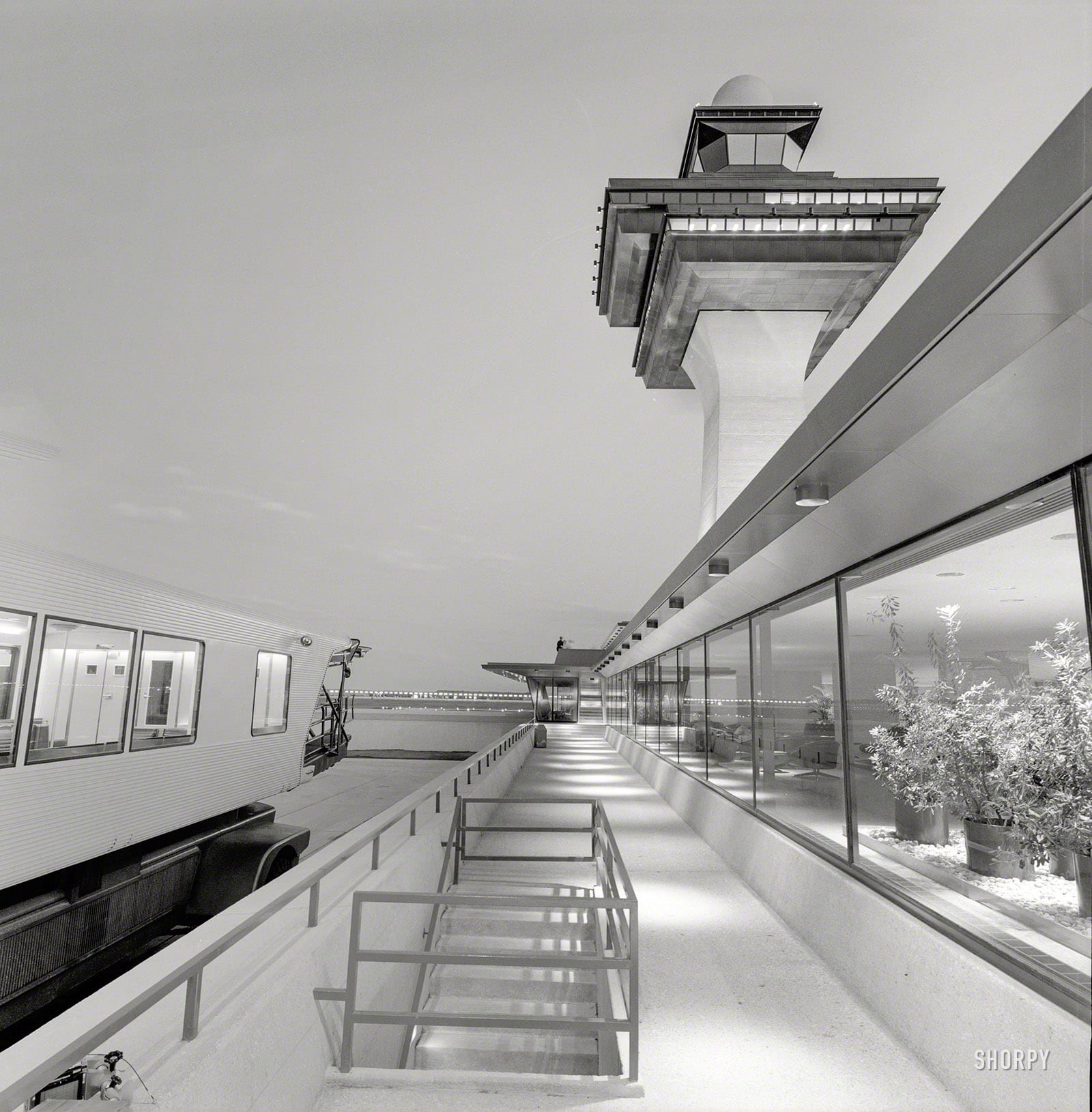 """Dulles International Airport, Chantilly, Virginia, 1958-63. Eero Saarinen, architect. Mobile lounge, control tower and terminal."" All we need now is an airplane. Medium format negative by Balthazar Korab."