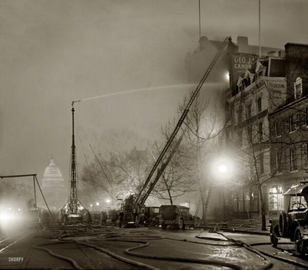 """December 28, 1925. """"G.J. Mueller Fire."""" A five-alarm fire at George J. Mueller Candy Co. in Chinatown at 336 Pennsylvania Avenue N.W., in view of the Capitol. National Photo Company Collection glass negative."""