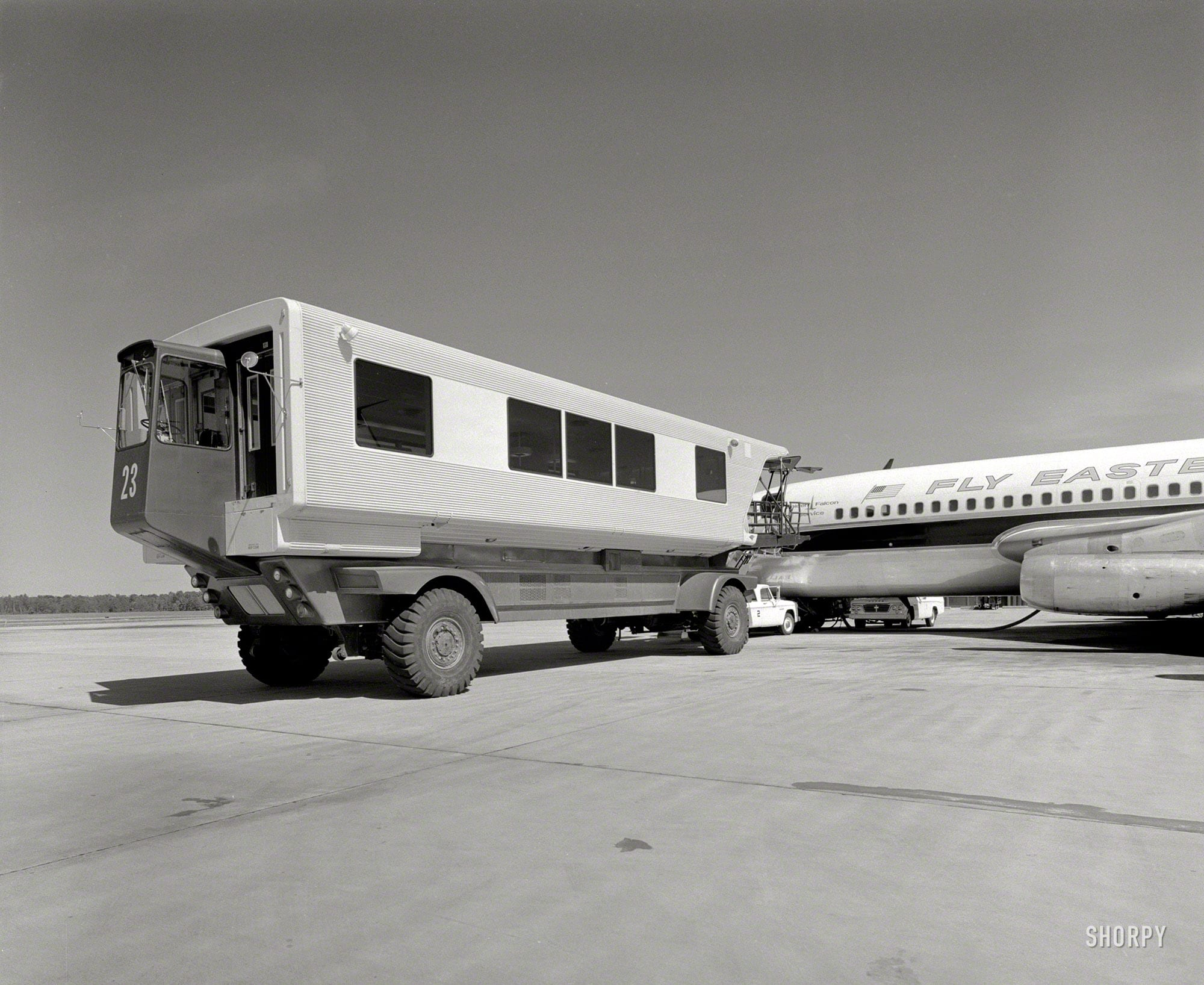 "A more complete view of the ""mobile lounge"" whose gangway was seen here yesterday. ""Dulles International Airport, Chantilly, Virginia, 1958-63. Eero Saarinen, architect. Mobile lounges."" Photo by Balthazar Korab."