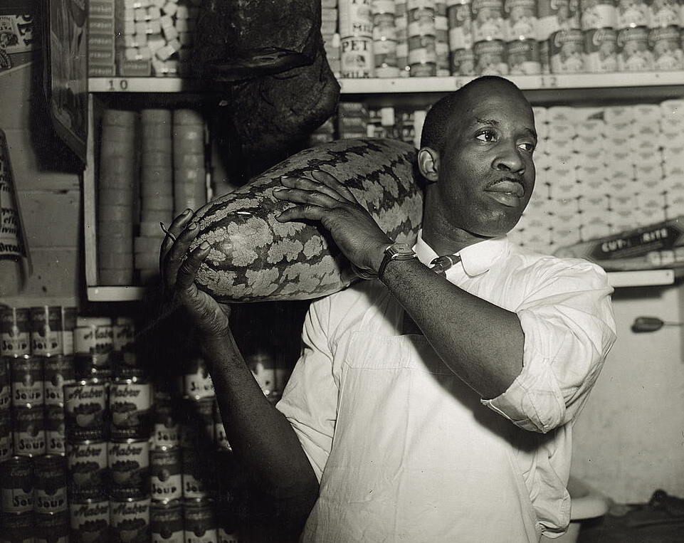 Washington, D.C. Mr. J. Benjamin, owner of the grocery store patronized by Mrs. Ella Watson, a government charwoman