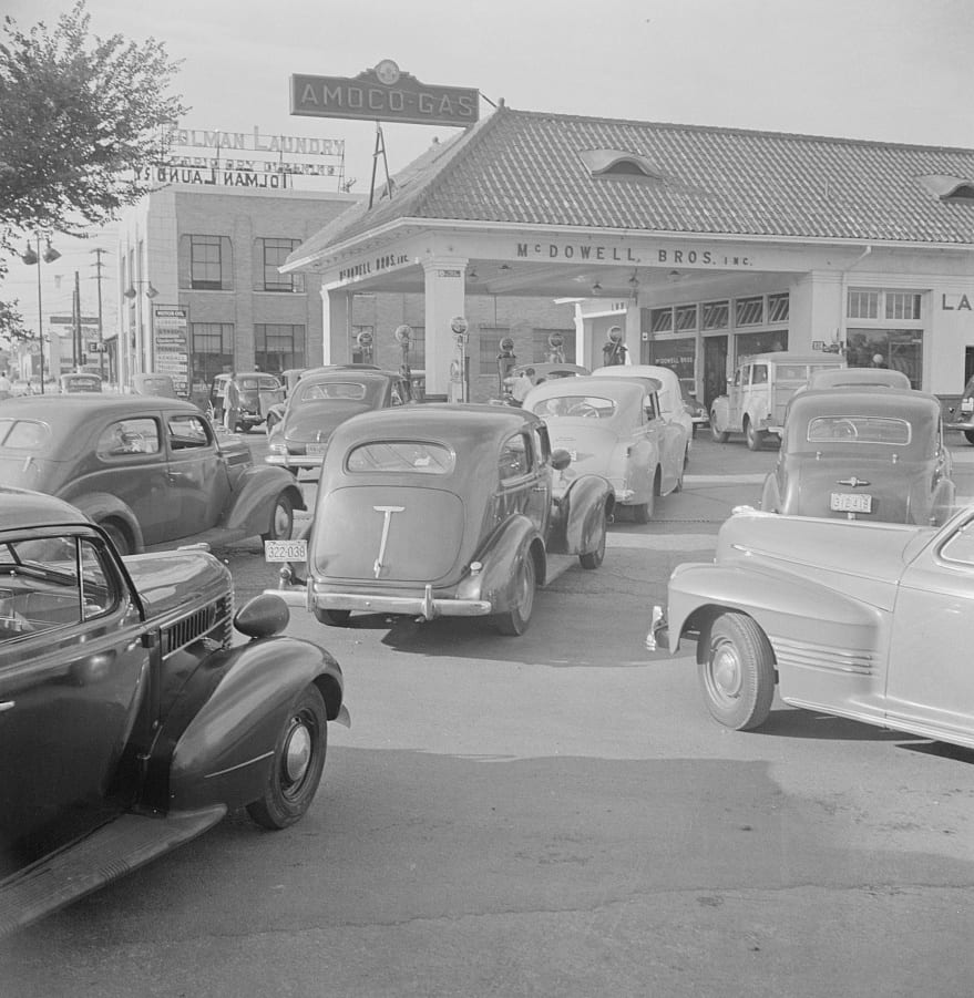Washington, D.C. At 7 a.m. on June 21st, the day before stricter gas rationing was enforced, cars were pouring into this gas station on upper Wisconsin