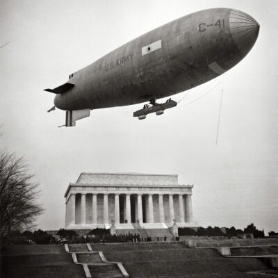 """February 1930. Washington, D.C. """"Army Airship C-41 lands on Mall and airmen, led by Brigadier General William J. Flood of the 19th Airship Company, place wreath at Lincoln Memorial, honoring Lincoln's Birthday."""""""