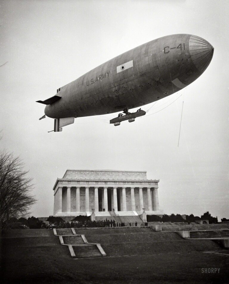 "February 1930. Washington, D.C. ""Army Airship C-41 lands on Mall and airmen, led by Brigadier General William J. Flood of the 19th Airship Company, place wreath at Lincoln Memorial, honoring Lincoln's Birthday."""