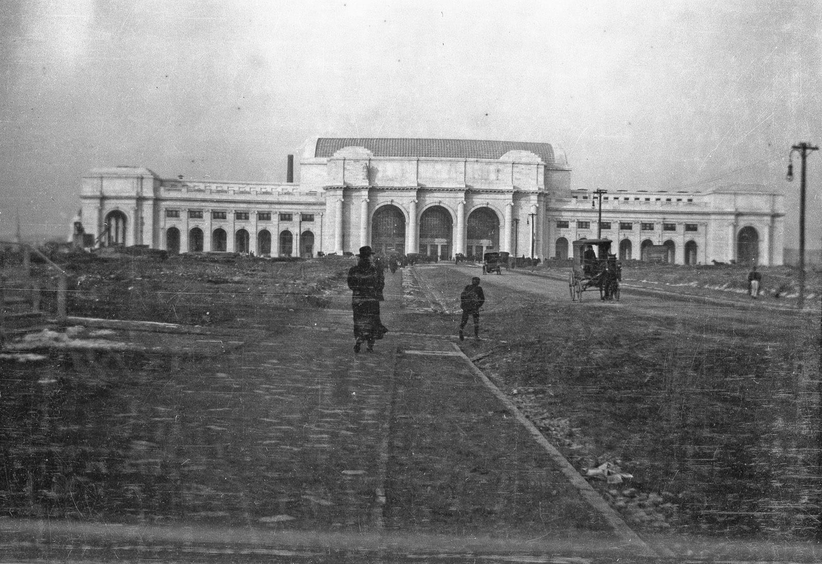 Taken by Sidney Duff in Washington, DC. Union Station was completed in October 1908. Here, only one of the six statues have been installed over the entrance. Another photo from the set shows the Tidal Basin frozen over, causing me to guess that this is January 1908.