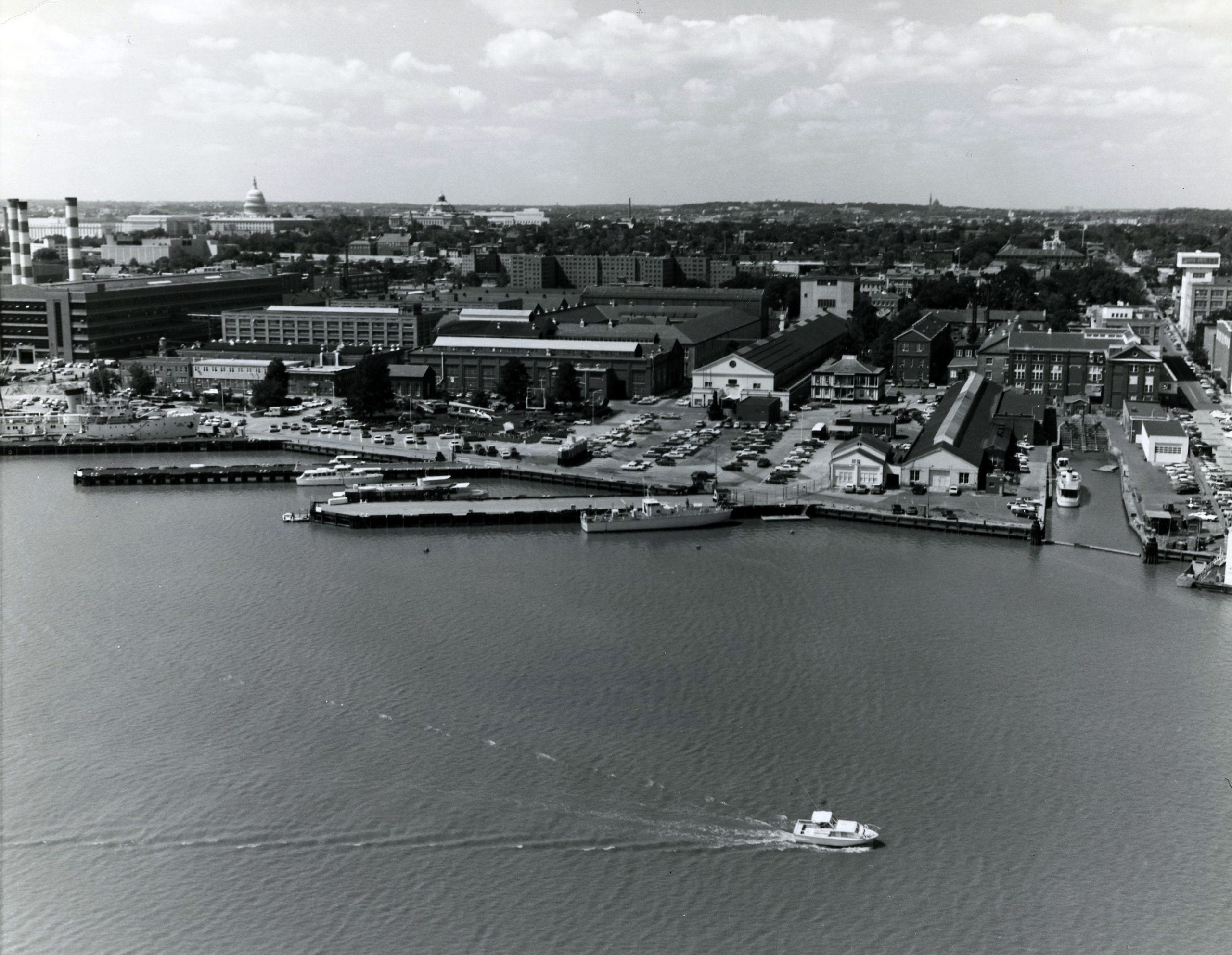 428-GX-KN-79297: Aerial view of the Washington Navy Yard, Washington, D.C., with the Anacostia River in the foreground. Photographed by PHC Tommy Cobb, March 1970. NHHC Photograph Collection, Navy Subject Files, Washington Navy Yard. (218).