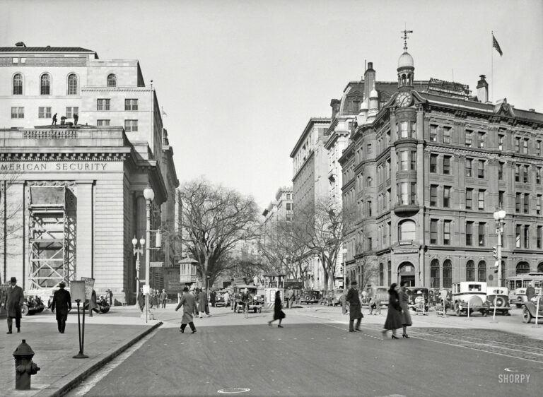 """Washington, D.C., circa 1931. """"Fifteenth Street at Pennsylvania Avenue."""" Note the traffic lights, which made their D.C. debut in 1926, as well as the traffic-cop gazebo at center (""""NO LEFT TURN"""") and streetcar switch tower to its left. Harris & Ewing Collection glass negative."""