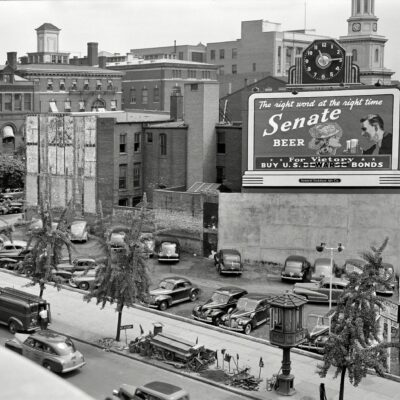 """1942. """"Effect of gasoline shortage in Washington, D.C."""" Note the streetcar control tower. Photo by Albert Freeman, Office of War Information."""