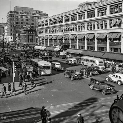 "October 1935. Washington, D.C. ""Capital Transit buses, F and 13th sts. NW."" Just direct your feet to the sunny side of the street."