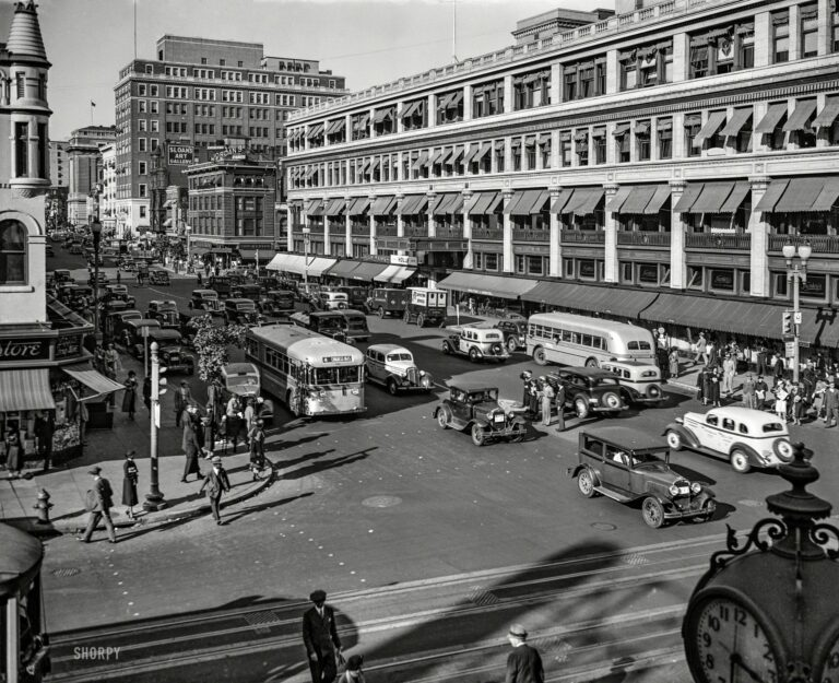 """October 1935. Washington, D.C. """"Capital Transit buses, F and 13th sts. NW."""" Just direct your feet to the sunny side of the street."""