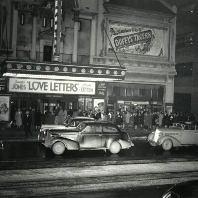 """A crowd lines up for the movie, """"Love Letters,"""" starrring Jennifer Jones and Joseph Cotton, at the Republic Theatre on the north side of the 1300 block of U Street, 1945-1946."""