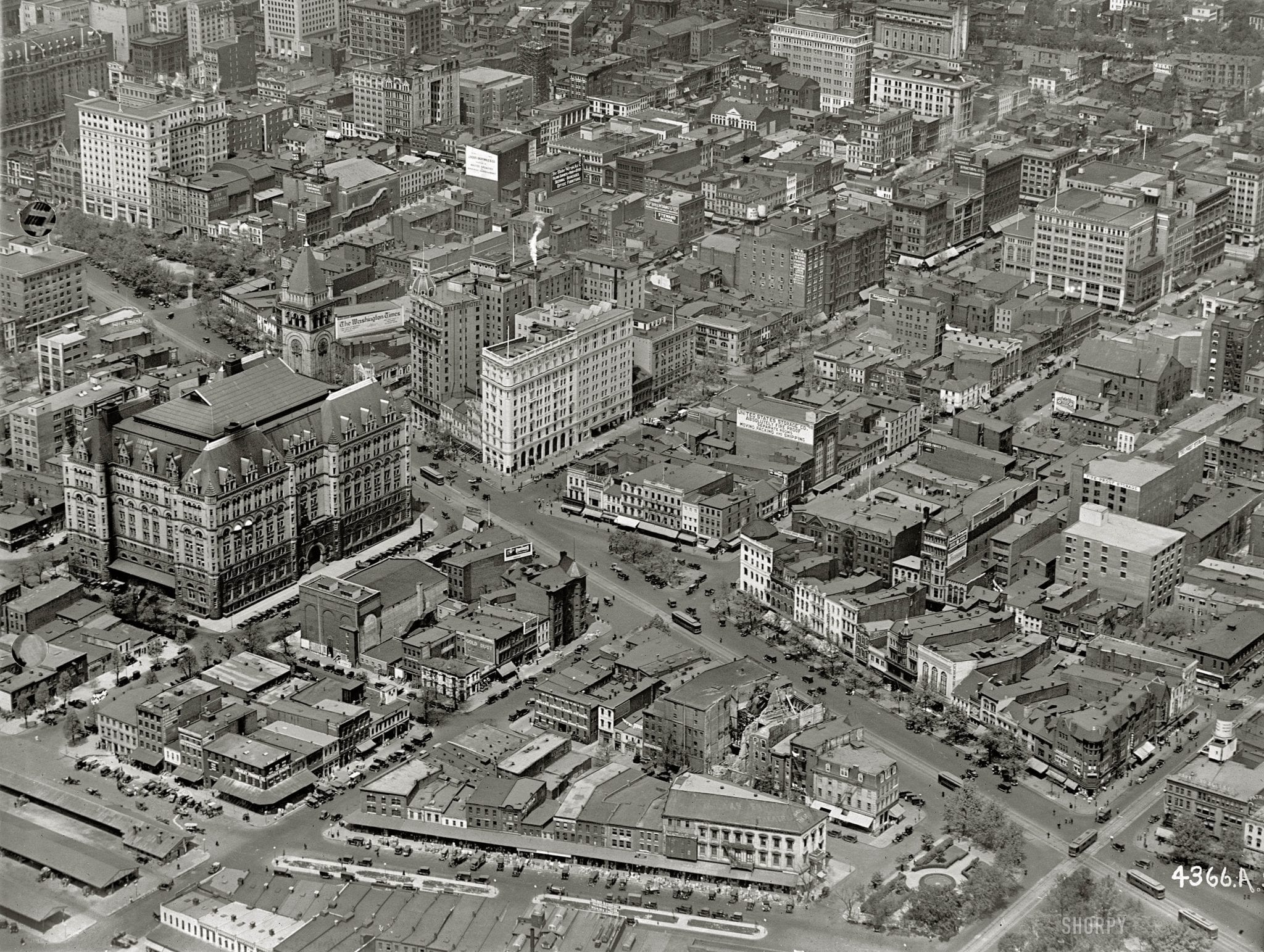 """Washington, D.C., circa 1922. """"Star Building from air."""" The Washington Star newspaper building at the center is at the intersection of 11th Street N.W. and Pennsylvania Avenue, which runs diagonally across the photo. The big building with the tower us the Old Post Office. There's a lot to see here, including laundry hung out to dry. National Photo Company glass negative."""