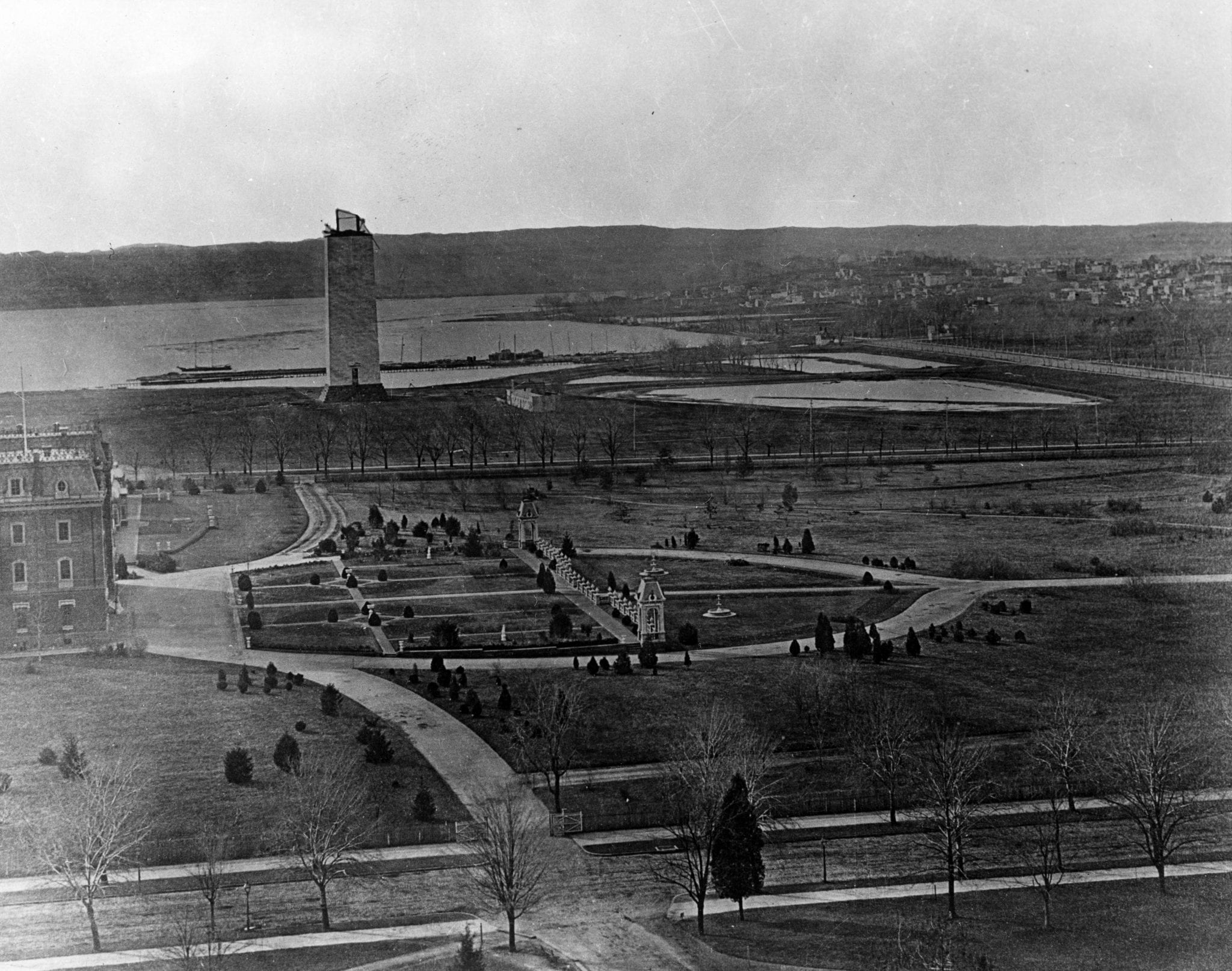 1877 view of the Washington Monument under construction as seen from the Tower of the Smithsonian (now the Smithsonian Castle)