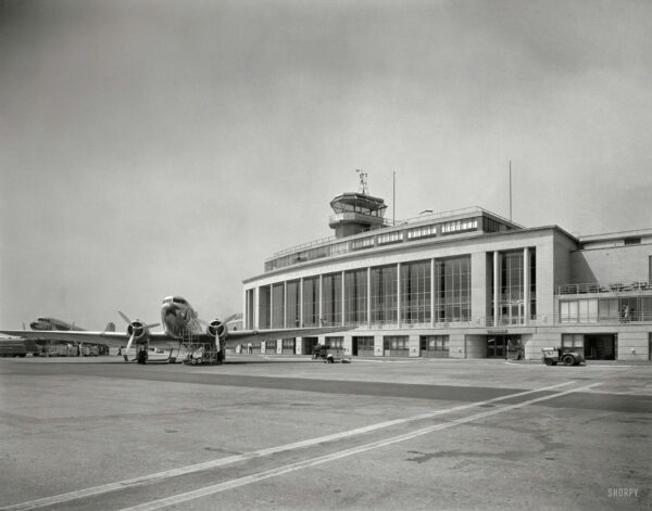 """Arlington County, Va., circa 1941. """"National Airport. Plane in front of passenger terminal and control tower."""" Photo by Theodor Horydczak."""