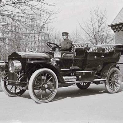 The President's 40-horsepower White Model M steam-powered touring car. March 1909. Photographed on the White House grounds in the early days of the Taft administration. In the back is the State Department, now the Eisenhower Executive Office Building. George Grantham Bain Collection.