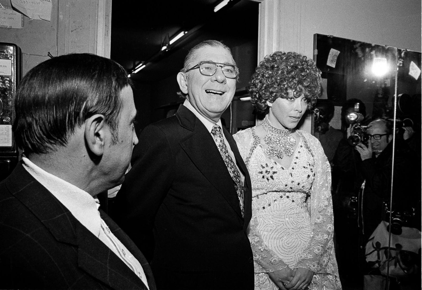 "Arkansas Rep. Wilbur D. Mills is photographed with Fanne Foxe, an infamous exotic dancer, who became known as ""The Washington Tidal Basin Bombshell,"" after she jumped into the tidal basin to escape police who had pulled over the intoxicated Mills and found Foxe in the car on Oct. 7, 1974. Despite the scandal, Mills was re-elected just a month later in November 1974."