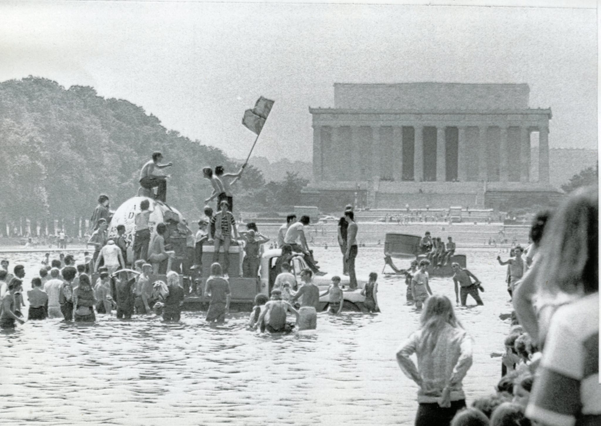 Protesters at the July 4, 1970 Honor America Day celebration wave a Viet Cong and a marijuana leaf flag atop a lighting truck they had pushed into the reflecting pool near the Lincoln Memorial in Washington, D.C.