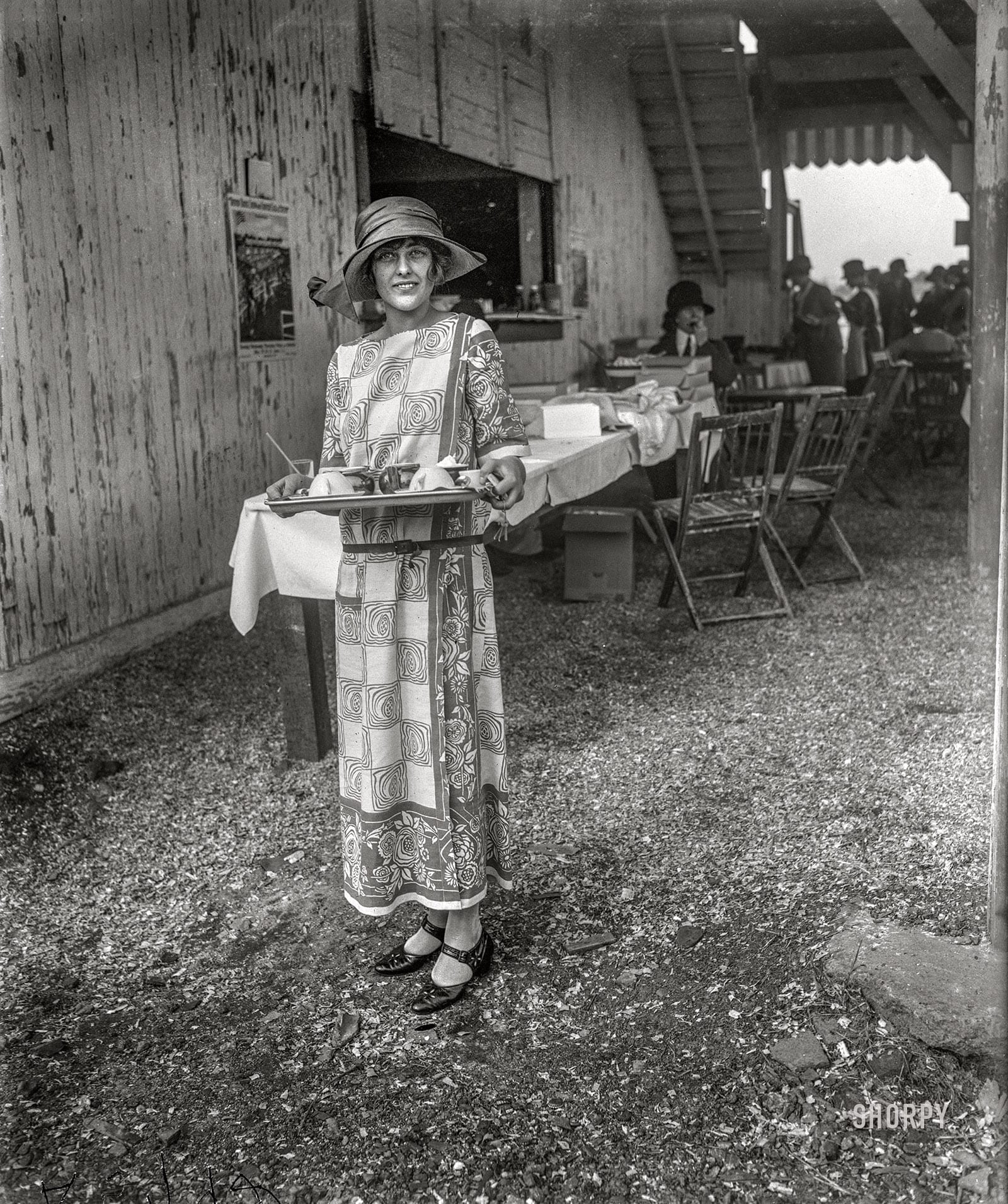 "May 16, 1923. ""Arlington Park, Virginia. Evelyn Wadsworth, daughter of Senator and Mrs. Wadsworth of New York, serving cold drinks at the National Capital Horse Show."" Harris & Ewing Collection glass negative."
